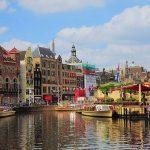 studera utomlands i Amsterdam, nederländerna, kanal, solsken